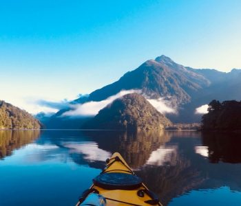 Kayak on the ocean with a mountain view